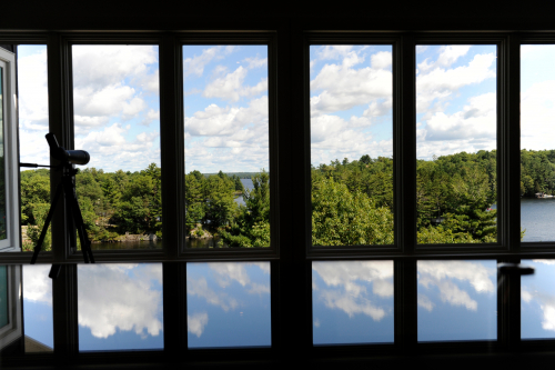casement windows looking at view of lake